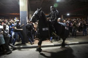 Protesters, whom are mainly Israeli Jews of Ethiopian origin, run away as a policeman on a horse tries to disperse them during a demonstration against what they say is police racism and brutality