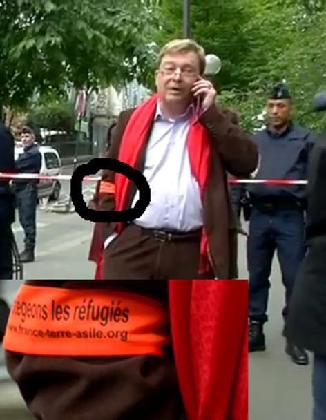 Pierre Henry, directeur général de France-Terre d'Asile, avec son brassard orange de flic humanitaire